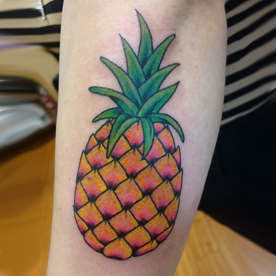Traditional pineapple tattoo, colors: black, pink, yellow, green