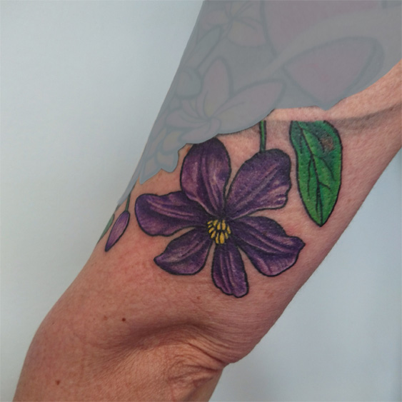 colorful, botanical Clematis tattoo