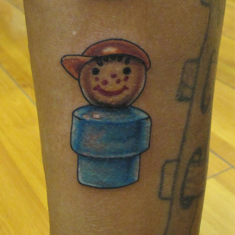 Colorful semi-realitisc toy tattoo