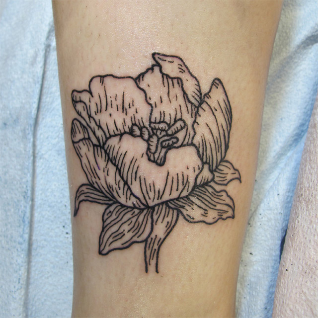 Tattoo of a flower in lineworktattoo and woodcuttattoo style, botanical tattoo